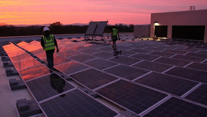 Sigora Solar installing panels at the Chartered Financial Analyst Institute in Charlottesville in April 2014.