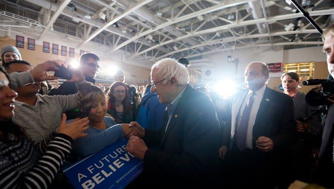 Democratic presidential candidate Sen. Bernie Sanders I-Vt. shakes hands during an event at Grinnell College Monday, Jan. 25, 2016.