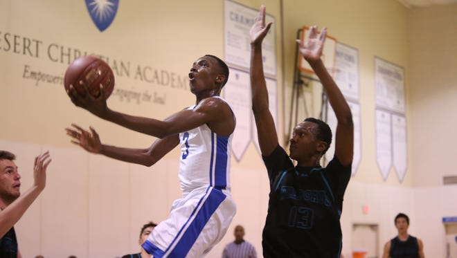 Desert Christian Academy's Ananais Bullock goes up for a lay-up against Gus Tadale of Renaissance Academy during the game in Bermuda Dunes on Tuesday, February 23, 2016.