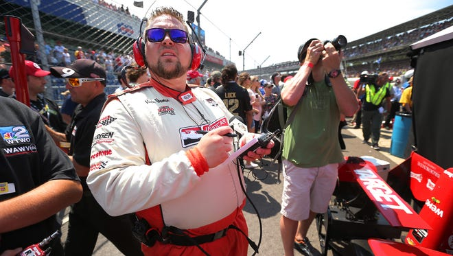 Nick Yeoman makes notes for his pit report during the 99th running of The Indianapolis 500.