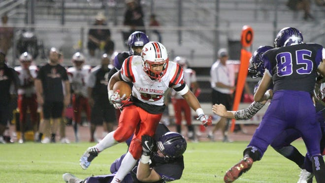 Shadow Hills' Timothy Lew trips up Palm Springs' Joshua Barlow during the second quarter in Indio on Friday, October 21, 2016.