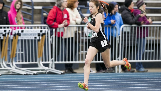 Sprague's Ginger Murnieks competes in the 1500 meter at the Greater Valley Conference district track and field meet on Friday, April 12, 2017, at West Albany High School. Murnieks went on to win the race.