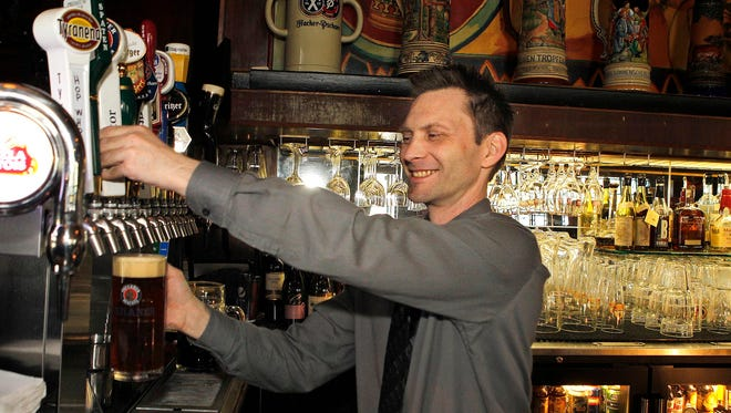 Chad Prochnow, manager at Von Trier, pours a beer in 2012.