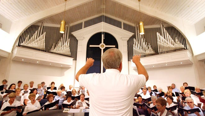 Led by Director Douglas Renfroe, Voices of Naples is seen rehearsing at the Naples United Church of Christ.