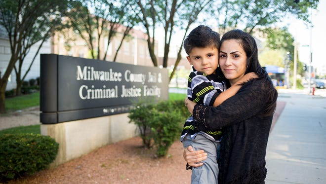 Melissa Hall and her son Jesus are shown outside the Milwaukee County Jail.