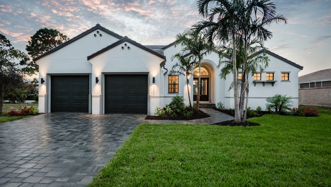 Frey & Son Homes has completed its Key Biscayne model at 27293 J C Lane in Bonita Springs.