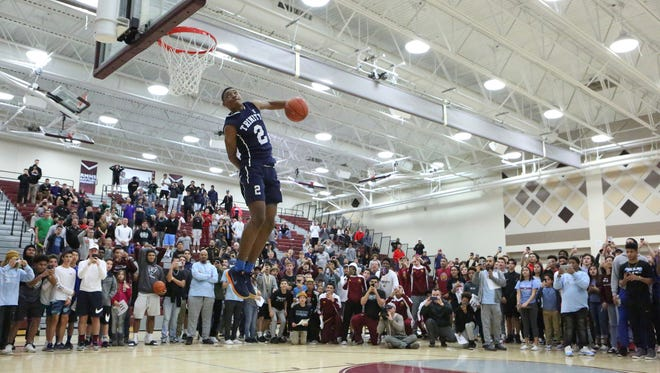 Trinity Prep's Deon Stroud showcases his skills during the dunk contest at the Rancho Mirage Holiday Invitational in Ranch Mirage on Thursday, December 28, 2017. Stroud won the contest.
