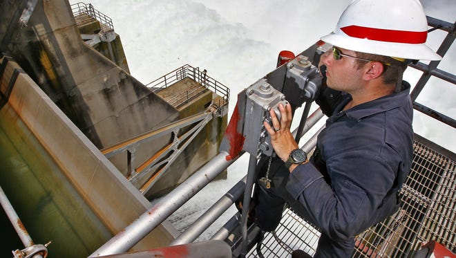 Cory Rice, a mechanic for the U.S. Army Corps of Engineers, watches one of the 12 gates on the Hartwell Dam Project release water from the Hartwell reservior in 2013.