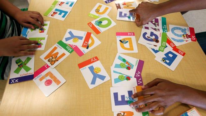 Children work on a literacy unit at Milwaukee's Next Door Foundation.