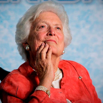 Former first lady Barbara Bush listens to her son,