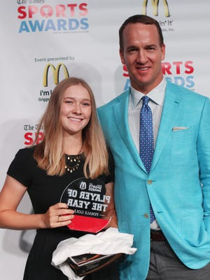 Peyton Manning poses with Female Golfer of the Year Alden Wallace (Loyola) at the Shreveport Times Sports Awards at the Shreveport Convention Center in Shreveport, Monday, May 15, 2017.