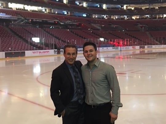 Red Wings play-by-play broadcaster Ken Daniels, left, poses with his son Jamie at BB&T Center in Sunrise, Fla., in late 2016, shortly before Jamie died suddenly in his sleep that December.