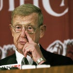 Lou Holtz wipes away a tear while announcing his retirement during a press conference Monday November 22, 2004 at Williams-Brice Stadium in Columbia, SC. Staff/Bart Boatwright