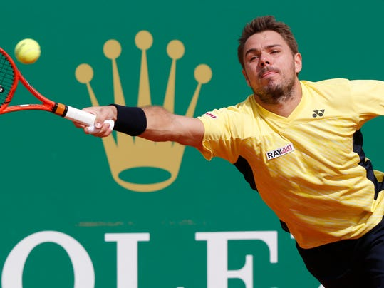 Stanislas Wawrinka of Switzerland, returns to the ball to Milos Raonic of Canada during their quarterfinals match of the Monte Carlo Tennis Masters tournament in Monaco, Friday, April 18, 2014. Wawrinka won 7-6 6-2. (AP Photo/Michel Euler)