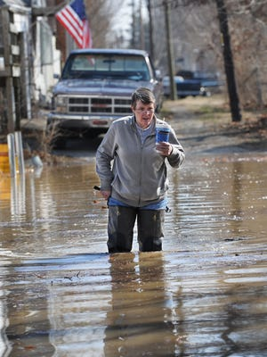 Cindy Norman of Indianapolis makes her way back to her flooded home after coming back from breakfast as she and others in the Ravenswood area continue to deal with rising flood waters that keep growing as the day progresses on Tuesday, March 1, 2011. (Matt Detrich / The Star)