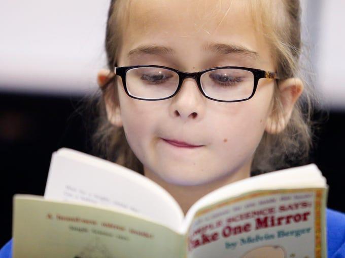 Lowe Elementary's Penelope Damron reads Take One Mirror.   Oct. 10, 2013