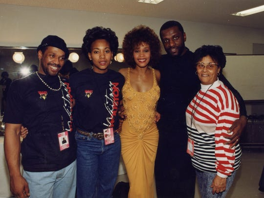 "Whitney's brother Michael Houston, friend Robyn Crawford, Houston, brother Gary Houston and Ellen ""Aunt Bae"" White pose backstage in a photo seen in the documentary."
