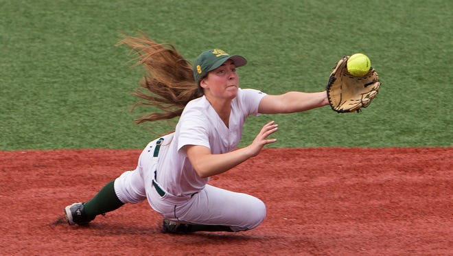 Red Bank Catholic's Anne Fiego makes a diving catch for the second out in the third inning. Red Bank Catholic vs Marlboro SCT Tournament Girls Softball game in Red Bank, NJ on May 24, 2016.