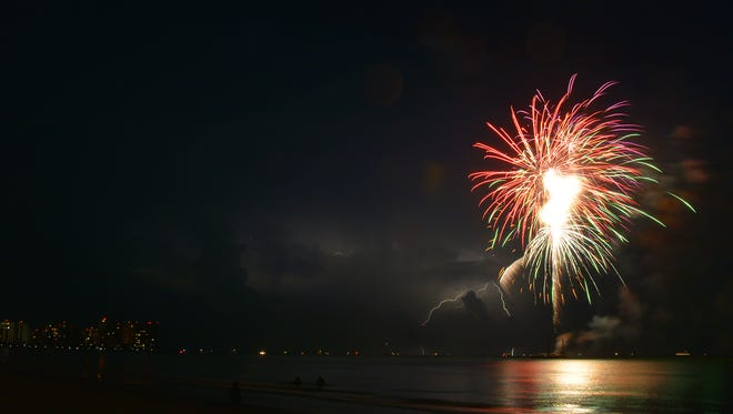 File 2015: Distant lightning adds to the show. The skies cleared for Marco Island's Fourth of July fireworks show  giving thousands on the beach the show they wanted.