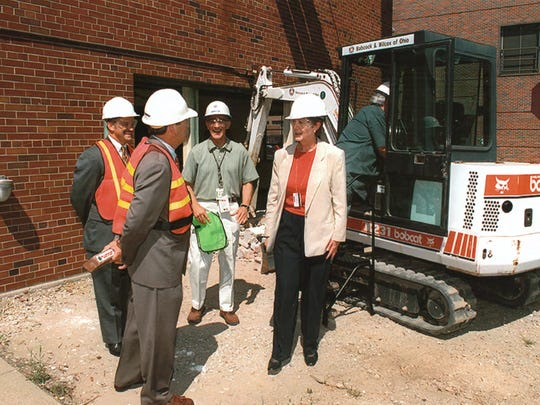 Carolyn Huntoon watches the start of contaminated building destruction at the Department of Energy site in Mound, Ohio, in 1999.