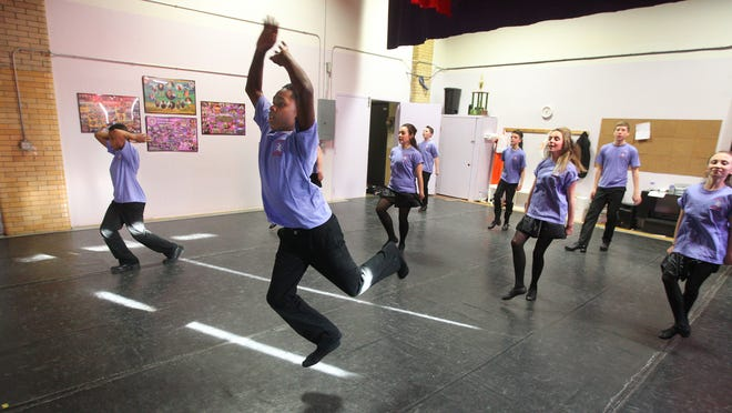 Jahkier Moore, 11, front center, and Brayden Beckley, 10, left, rehearse with dancers from Drumcliffe Irish and Contemporary Dance School, which is putting together a cross-cultural performance that blends Irish dance and step dancing.