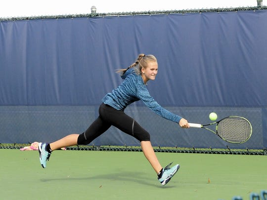Morgan Coburn of Indian Hill shows off her backhand