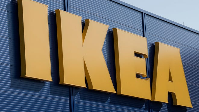 """FILE - This is a Wednesday, Aug. 23, 2017 file photo of the IKEA sign at the  IKEA furnishing store in Magdeburg, Germany. Swedish furniture retailer Ikea said Tuesday Oct. 10, 2017 that it will start selling its goods through third-party web sites as a test """"but no decisions made regarding what platforms/markets will be in the pilot."""""""