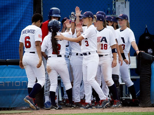 Brittany Gomez (2), of the United States, is congratulated after scoring during a women's baseball game against Venezuela at the Pan Am Games Monday, July 20, 2015, in Ajax, Ontario. Women's baseball made history on Monday at the Pan Am Games, the first time it has been played in a large, multi-sport event.