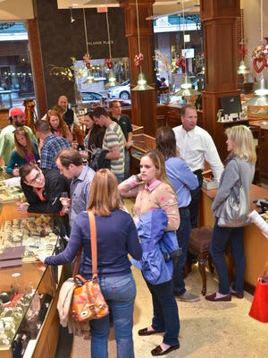 People mingle during the first Palafox Wine Walk at Jewelers Trade Shop.