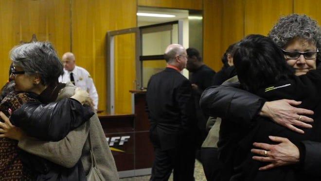 Friends of Edline Chun hug after the sentencing of Jerrell Henry on Tuesday.