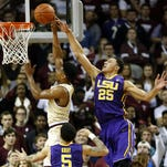 LSU's Ben Simmons (25) goes up to block the shot of College of Charleston's Cameron Johnson during Monday night's game.