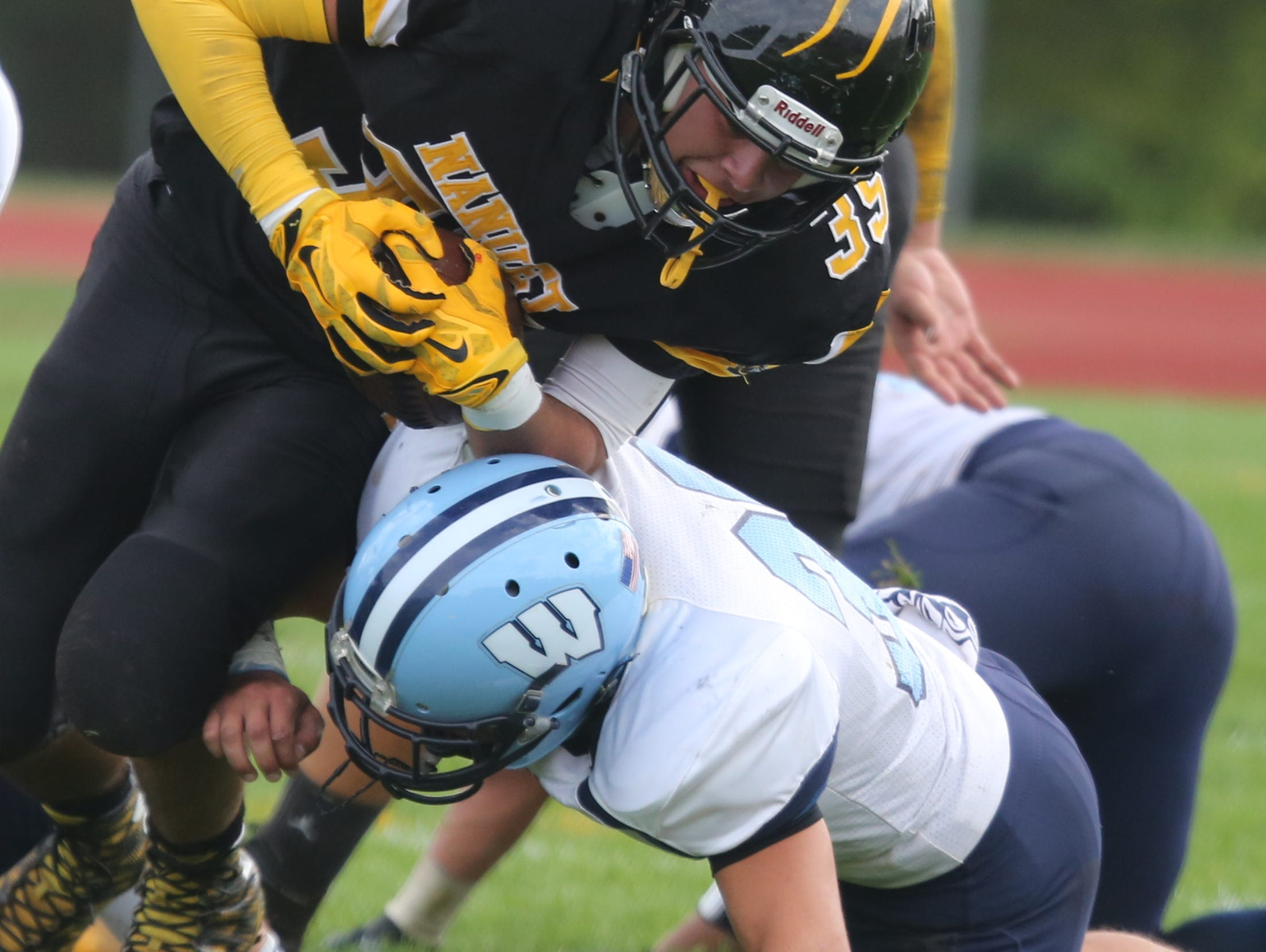 Nanuet's Matthew Sassoon is tackled during action in the Nanuet vs. Westlake football game in Nanuet, Sept. 26, 2015.