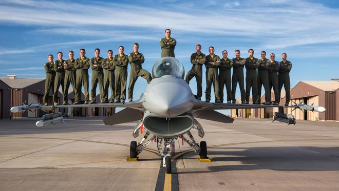 Class 15-BBH, the inaugural class from the 314th Fighter Squadron, stands on top of an F-16 Fighting Falcon at Holloman Air Force Base. Over 60 percent of the 17-man class will be going overseas following their June 25th graduation.
