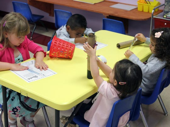 Mozarts and Einsteins, a new preschool that just opened at 175 Gatzmer Ave. in Jamesburg is photographed on Thursday June 4 ,2015. Students work during music class.