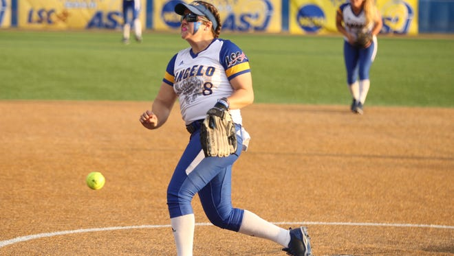 Angelo State University's Brandy Marlett unleashes a pitch in a 7-6 win against Texas A&M-Commerce in Game 1 of a best-of-three NCAA D-II South Central Super Regional softball series Thursday night at Mayer Field. The Belles will return to the World Series for a second straight year with a win Friday.