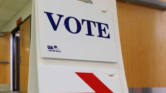 A sign points voters to the ballot box in Westchester County