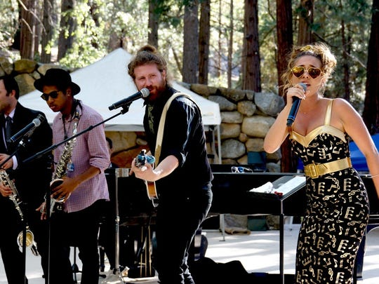 Haley Reinhart (right), shown performing with Casey