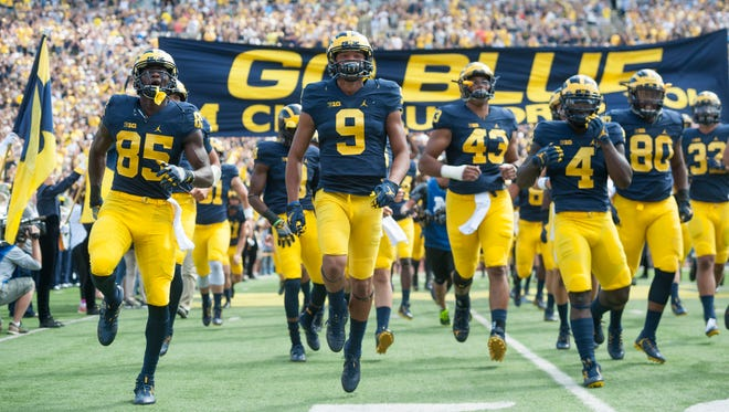 Michigan's athletic department projects an operating surplus of $2 million in 2018.