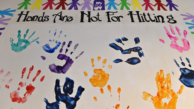 Children at Crossroads Safehouse are asked to pledge that they won't use their hands to hit. Crossroads provides shelter and resources for victims of domestic violence.