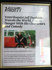 A Variety article posted in Barry Shelden's auto repair shop features a photo of comedian Jeff Dunham in a VW bus Shelden sold to the comedian.