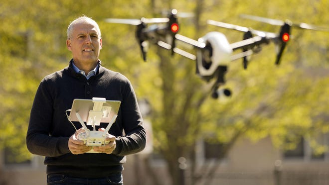 DroneLinx CEO Steve Metzman operates a drone to make videos and still images of an apartment building in Philadelphia.