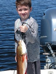 Young Nathan Kelly with a 5-pound redfish he caught