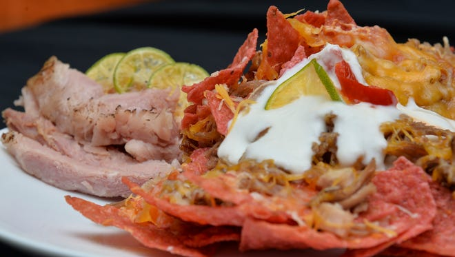 Thanksgiving Nachos, made with letover turkey, ham, melted cheese and tortilla chips, wastes not in the Pacific Daily News breakroom on Nov. 22, 2016.