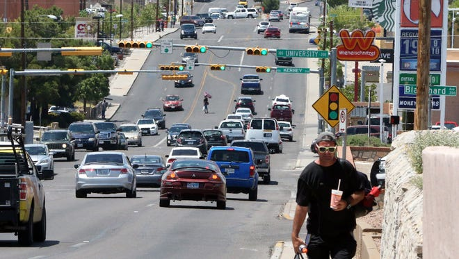 Traffic flows Friday afternoon along North Mesa Street at University Avenue near the University of Texas at El Paso. A master plan for Mesa Street is being developed.
