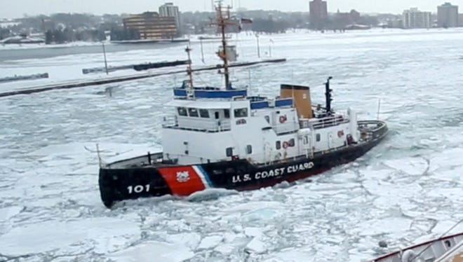 The U.S. Coast Guard cutter Mackinaw the largest icebreaker on the Great Lakes moves thick ice around in the shipping channel of the Soo Locks in Sault Ste. Marie, Michigan on March 20, 2014.