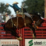Bareback rider Jacobs Crawley flies through the air during last year's Big Sky Pro Rodeo Roundup.