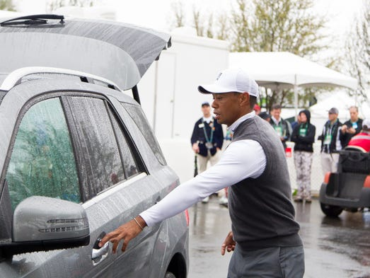 Tiger Woods leaves the golf course after finishing