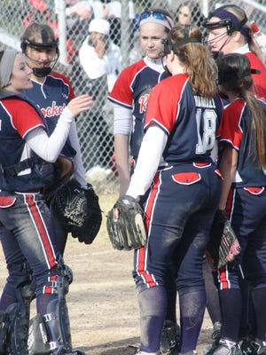 Westland John Glenn junior catcher Julia Michlowski (left) sets the strategy during a break in the Rockets' season-opening victory over Dearborn Heights Annapolis.