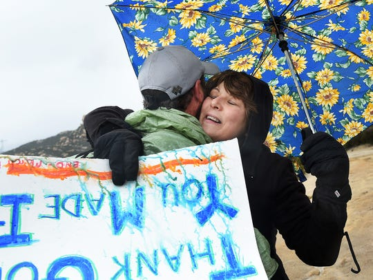 Winter time through hiker Shawn Forry receives a hug from his mother Pat after arriving at the southern terminus of their historic journey on the Pacific Crest Trail at the Mexican border near Campo, Calif. on March 1, 2015.