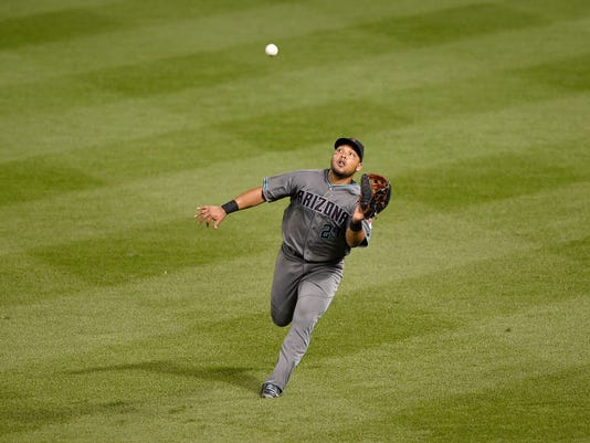 Arizona Diamondbacks right fielder Yasmany Tomas tracks a fly ball by Baltimore Orioles' Adam Jones during the third inning of a baseball game, Friday, Sept. 23, 2016, in Baltimore. Tomas made the catch for an out. (AP Photo/Nick Wass)